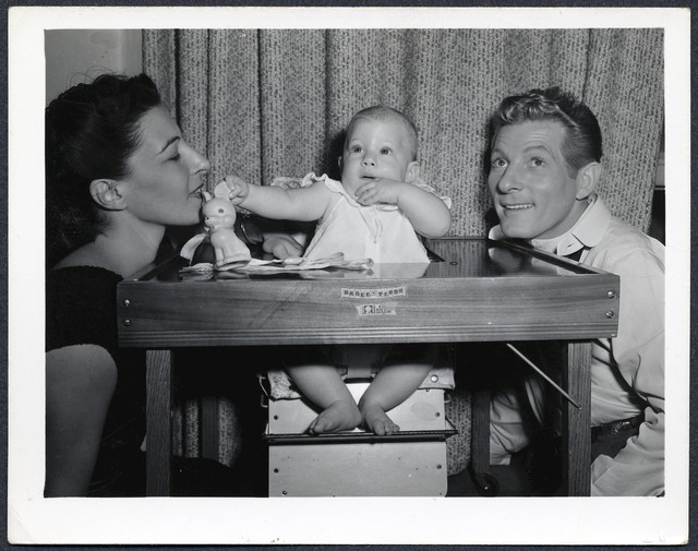 [ Sylvia, Dena (baby) and Danny around a small table (date unknown, most likely 1947)]