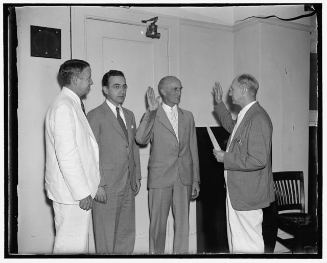 Takes oath of office as member of Social Security board. Washington, D.C., Aug. 9. George E. Bigge, of Providence, Rhode Island, today taking the oath of office as a member of the Social Security Board to succeed the former Chairman John J. Winant. A former professor of economics at Brown University, Bigge was also the first Chairman of the Unemployment Commission of Rhode Island. In the photogrpah, left to right: Vincent M. Miles, member of the Board; Arthur J. Altymeyer, Chairman of the Board; George E. Biggie, and George E. Scott, Cheif of the Bureau of Business Management of the Social Security Board, who administered the oath, 8/9/37