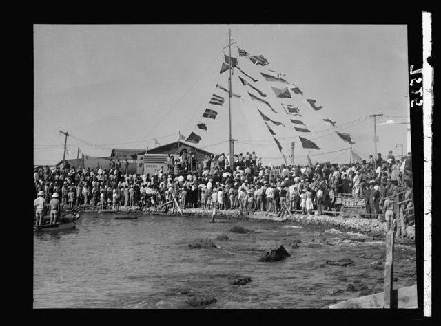 Tel Aviv. Jetty celebration, May 19, '37. Opening ceremony of celebration. Raising Jewish flag