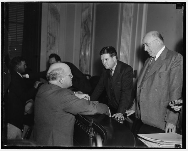 "Terrorism witness before Senate. Washington, D.C. Jan. 15. Yelverton Cowherd, of Birmingham, Ala. testified today before La Follette's Committee on Civil Liberties that he was retained as Chairman of a ""Special Americanization Committee"" of the American Legion. He also testified that Walter J. Hanna was seen on the day of the flogging of Joseph Gelders in the reign of terror in Alabama. Photo shows Cowheard on the stand. Left to right are: Senator Elbert D. Thomas of Utah; Sen. Robert M. La Follette, Jr., or Wis. Chairman of [the] Committee; and Yelverton Cowherd"