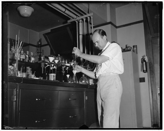 Testing cosmetics at Department of Agriculture Washington D.C. July 10. Dr. D.C. Grove, of the Dept. of Agriculture is shown giving a shakedown test of different creams to get the fattening material from the product [...]