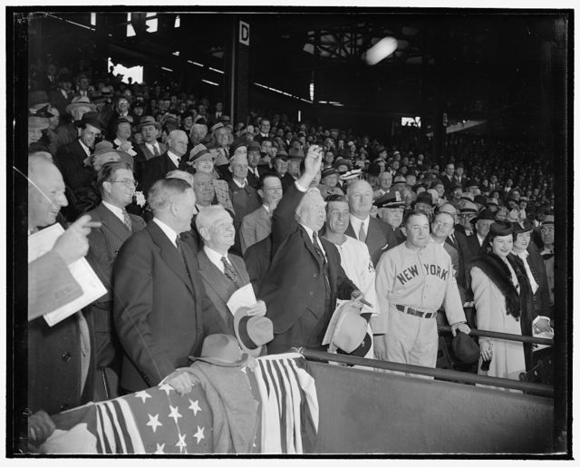 The ball goes out and the game is on. Washington, D.C., April 21. Baseball really isn't ushered in until the ceremony of throwing out the ball is accomplished. Vice President John Garner did the honors today in the absence of President Roosevelt. Left to right. Senators Pat Harrison, Robert Lafollette Jr., Charles L. McNary, Carter Glass, the Vice President, Bucky Harris who manages the Washington Senators, Postmaster General James A. Farley, N.Y. Yankees' Manager Joe McCarthy. Senator Allen J. Ellender is standing behind the Vice President