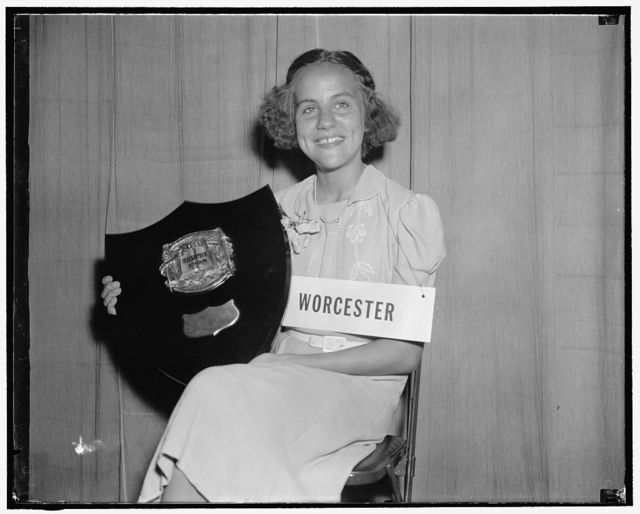 The winnah! Washington, D.C., May 29. Spelling the word 'homogenuity' correctly, Elizabeth Rice, 12-year-old eighth grade student of Worcester, Mass., today won the 15th annual spelling bee. She received a plaque and $500 as the first prize
