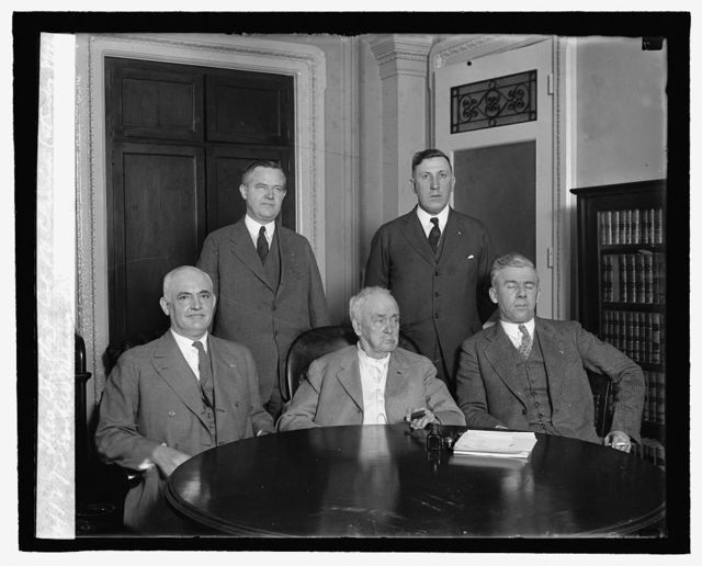 Theo. Stitts & Col. J.V. Climie (standing), Sen. R.W. Means, Jas. Tanner, Howard P. Savage, 2/18/27