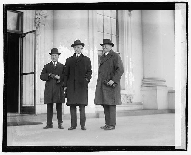 [Three men standing outside building], 12/6/20