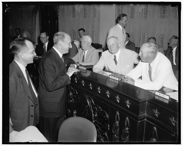 Treasury Head asks changes to plug tax leaks. Washington, D.C. June 17. While the Treasury Department is temporarily withholding the names of alleged tax dodgers, Secretary Morgenthau appeared before a Joint Congressional Tax Committee today to recommend immediate legislative enactments to close loopholes in the Federal Tax laws. In the photograph, left to right: Rosewell Magill, Undersecretary of the Treasury; Secretary Morgenthau; Rep. Robert L. Doughton, of North Carolina; and Senator Pat Harrison of Mississippi. 6/17/37