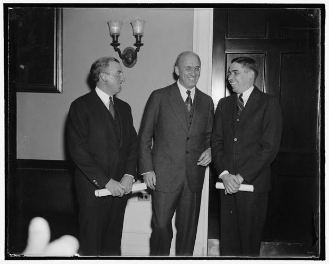 Treasury promotions. Washington, D.C., Oct. 31. John W. Hanes, left, today took the oath as Undersecretary of the Treasury, while Eugene S. Duffield, right, was sworn in as a special assistant to the Secretary. Secretary of Treasury Morgenthau seems happy over the selection of his new assistants. Hanes succeeds Roswell Magill and Duffield takes over the job made vacant by the promotion Cyril B. Upham to be Comptroller of the currency, 10/31/38