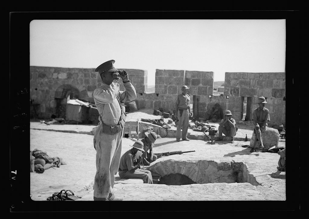 Troops on Tower of David, soldier using field glasses