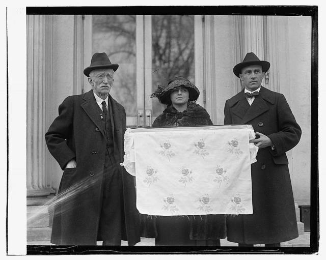 [Two men and woman holding fabric with rose pattern], 2/15/23