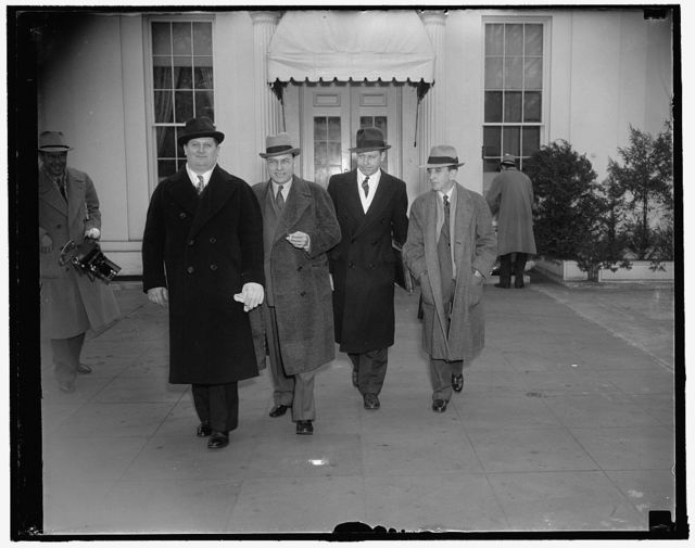 """UAWU leaders urge President to appropriate $130,000,000 for Michigan relief. Washington, D.C., Feb. 1. Led by Homer Martin, President, representatives of the United Automobile Workers Union called at the White House today and urged President Roosevelt to appropriate $130,000,000 for Michigan relief to avoid """"mass starvation and mass misery"""". They also left with the President their recommendations and a statement on employment, unemployment and average wage of workers in the auto industry. Left to right: Richard T. Frankensteen, Vice President; Homer Martin, President; William Munger, Research Director; and W. Jed Louck, Economist"""