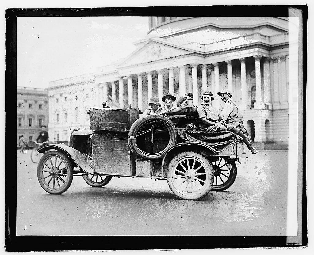 Unidentified persons in automobile in front of Capitol building], 9