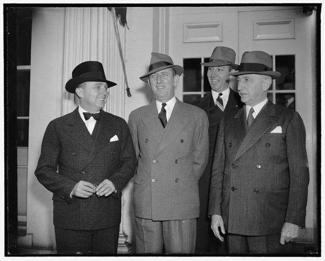 Urge clemency for Georgia bootlegger. Washington, D.C., May 16. Executive clemency was asked of President Roosevelt today for Sam Evans, Georgia farmer serving four years in Atlanta for manufacturing whiskey without a license. Georgia Governor E.D. Rivers (left) accompanied by Senator Richard B. Russell, Jr. (right) and Judge Robert H. Humphrey, Swainsville, Ga. made the plea to the President, 5/16/38
