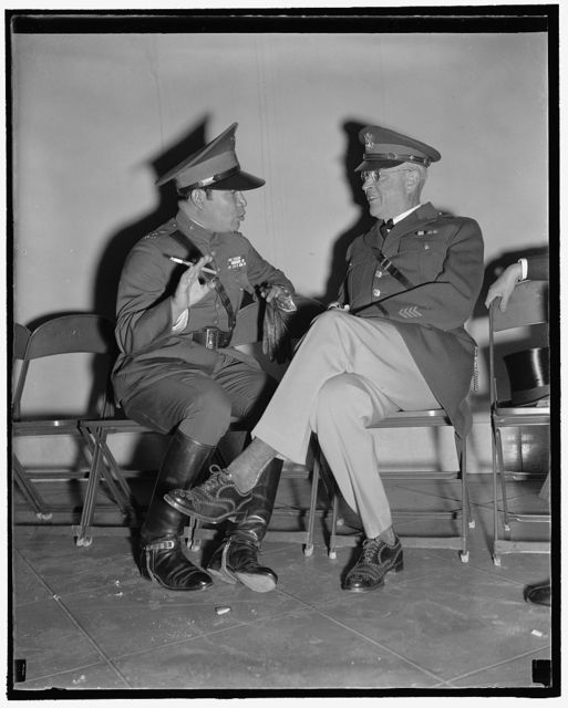 U.S. - Cuba military leaders. Washington, D.C., Nov. 11. No doubt armies were discussed when this picture was made today. Maj. General Malin Craig, U.S. Chief of Staff, and Col. Fulgencio Batista, Cuba's Dictator, as they chatted informally at Arlington while waiting for the arrival of President Roosevelt for the Armistice Day ceremonies there, 11/11/38