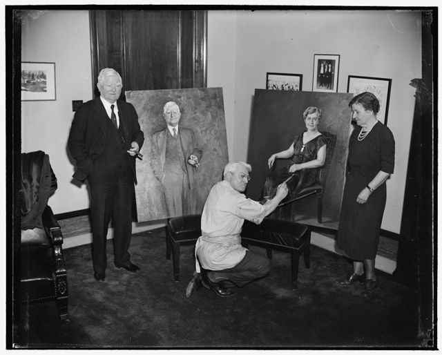 Vice President and Mrs. Garner pose for portraits. Washington, D.C., April 20. Seymour M. Stone, American artist, puts the finishing touches on the portraits of Vice President and Mrs. John N. Garner which he has recently completed. Artist Stone painted the two portraits in two weeks