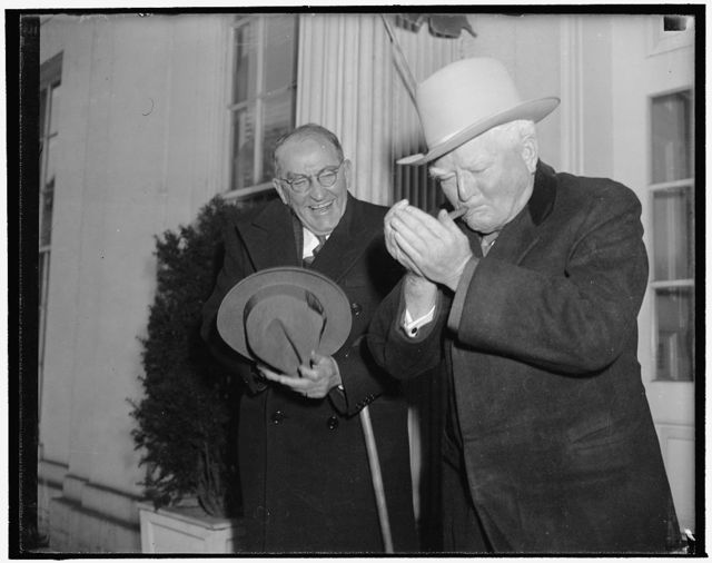 Vice President and Speaker in jovial mood as they leave conference with President. Washington, D.C., Jan. 2. Leaving the White House today with Vice President Garner after a conference with President Roosevelt, Speaker of the House William B. Bankhead chuckles as he tells reporters he has never seen a more brotherly, affectionate greeting in all his life, than the one the Chief Executive extended the Vice President. Bankhead said President Roosevelt greeted Vice President Garner at the conference by singing 'Happy New Year to You'