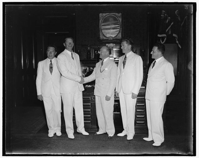 War Secretary greets Soviet Polar Flyers. Washington D.C. July 26. The second crew of Soviet Flyers to successfully fly from Moscow to the United States via the North Pole, were received by Secretary of War Harry H. Woodring today. In the photograph, left to right: Sergei Danilin, navigator; Andrei Yumasheff, co-pilot; Secretary woodring; Mikhail Gromoff, pilot; and Constantine A. Oumansky, counselor of the Soviet Embassy in Washington. 7/26/37