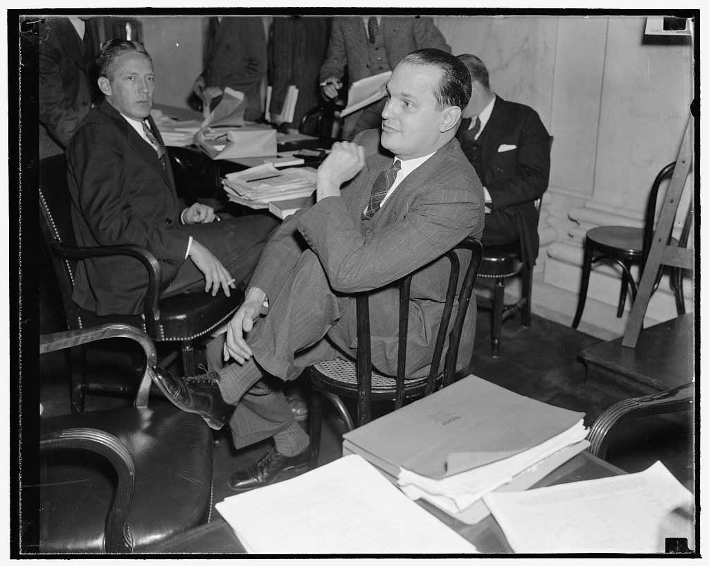 Washington, D.C., Dec. 3. Dr. Willard Thorp, Dun and Bradstreet Economist now with the Commerce Department, pictured as he listened to testimony before the Monopoly Committee today. He is a member of the Committee