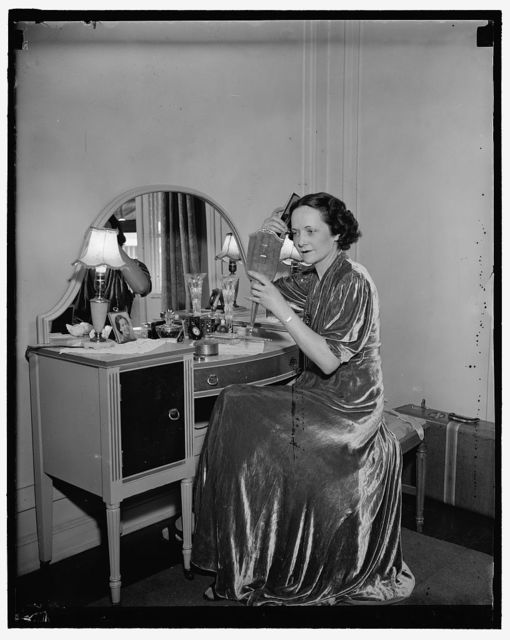 Washington D.C. July 27. One of the most beautiful of the Senate Ladies, Mrs. Claude Pepper, Wife of the Senator from Florida , needs little artificial makeup to enhance her beauty. She is shown at her dressing table getting ready for a Washington social affair. 7/27/37