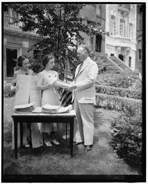 Washington, D.C., June 25. Cincinnati school children report 35,539 American Elms for the honor roll of the American Tree Association to mark the sesquicentennial of the framing of the constitution. Prof. Chester L. Miller of the Garfield School, and chairman of the Cincinnati City Beautiful Committee, presents the long list of names to the American Tree Association of Washington in front of the George Washington Elm which one stood at Cambridge, Mass. Receiving the lists from Mr. Miller are Genevieve O'Connell and Adelene Smallwood. The American Tree Association says this is the biggest municipal tree planting in the sesquicentennial tree planting campaign
