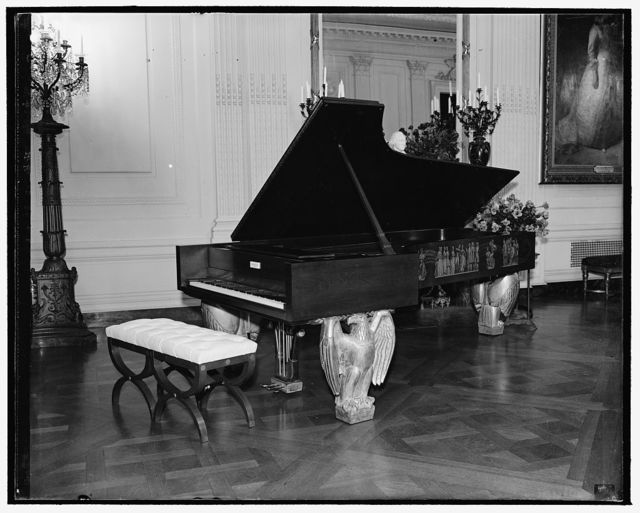 White House gold piano replaced with new instrument. Washington, D.C., Dec. 10. The gold piano which has occupied its place in the east room of the White House for years is to be replaced with a new one. It is the gift of Theodore Steinway. The old one will be placed in the National Museum. Mr. Steinway's gift, which was played by Josef Hofmann at the acceptance ceremony, is of maple, decorated in gold, with legs in the shape of eagles, 12/10/38