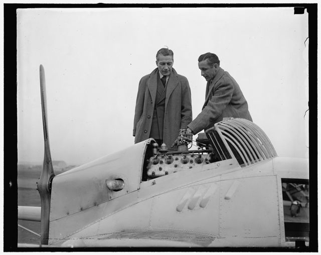 Widal inspects engine in new Flivver plane. Washington, D.C., Dec. 15. A new Flivver plane, powered with a Ford V-8 Motor and capable of a cruising speed of 95 miles an hour, was demonstrated to Eugene Vidal, Director of the Bureau of Air Commerce, Department of Commerce, today. The plane has a wing spread of 36 feet. A low gas mileage is claimed for the ship, 16 miles to the gallon, on its flight from St. Louis to Chicago in 2 hours, 33 minutes. Director Vidal is shown inspecting the motor with Hayden Campbell, of St. Joseph, Mo., who flew the plane here