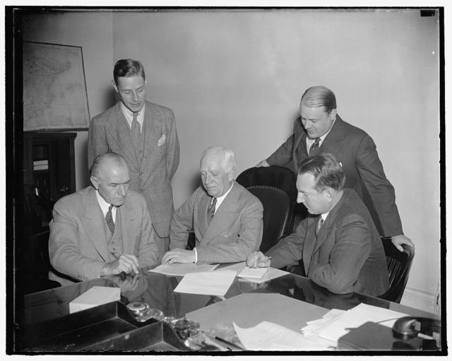 Will represent U.S. at nine power treaty conference in Brussels. Washington, D.C., Oct. 18. The United States Delegates to the Conference of Nine-Power Treaty Signatories [...] Brussels held their first meeting at the state [...] today to discuss preliminary arrangements. In the photograph, left to right: (Seated) Stanley [...], Advisor; Norman Davis, Chief Delegate; [...] P. Moffatt, Advisor. Standing, left to right: [...] E. Bohlen, Secretary; and Robert T. Pell, [...] Relations Officer, 10/18/37
