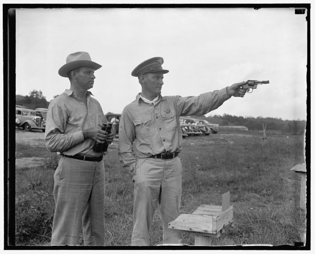 Winner and runner up in Treasury shoot. Washington, D.C., Aug 10. Averaging 298 out of a possible 300 bullseyes, L.E. Echols, (right) Customs Inspector at San Juan Puerto Rico, today won the Secretary's individual match in competition with marksmen from other agencies in the Treasury Department. On the left is A.L. Meloche, Alcohol Tax Unit; the runner-up with 297 out of a possible 300, 8/10/37