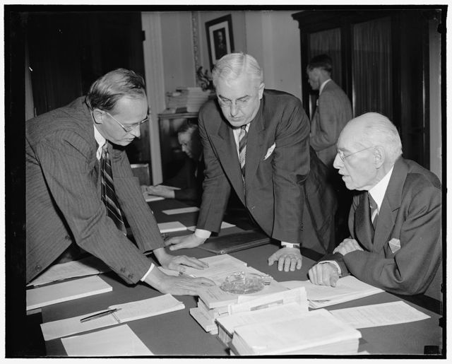 WPA Administrator Hopkins indicates to house plan to increase relief load. Washington, D.C., April 20. Appearing before the House Appropriations Committee today, WPA Administrator Harry Hopkins indicated in his testimony he was preparing to increase the relief load during the first seven months during the next fiscal year beginning July 1. Hopkins (left) is pictured as he explained the was figure which he said is necessary to President Roosevelt's $4,512,000,000 Recovery Drive, to Rep. Clifton A. Woodrum (center) Chairman of the Subcommittee, and Rep. Edward T. Taylor, a member of the Committee.