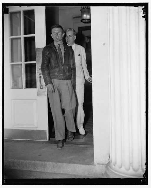 """""""Wrong Way"""" Corrigan calls on President. Washington, D.C., Aug. 31. """"Wrong Way"""" Corrigan, who paid Washington a surprise visit today, is shown leaving the White House after being presented to President Roosevelt. He is shown with Oswald Ryan, member of the Civil Aeronautics Authority, who introduced him to the Chief Executive, 8/31/38"""