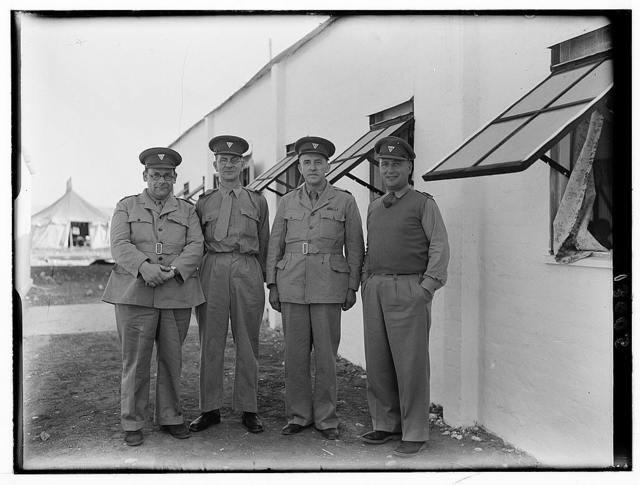 Y.M.C.A. celebration at Beit Nabala on May 21, '44. Group of four 'Y' secretaries. Mr. Carter, Mr. Willkins, Mr. Lyne, & Mr. [?]