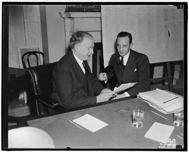 Young Ford blames ICC. Washington, D.C., Jan. 7. ICC order that all railroads use heavy equipment caused the Fords to sell the Detroit, Toledo, and Ironton Road in 1929, Edsel Ford, (right) President of the Ford Motor Co., told Chairman Burton K. Wheeler of the Senate rail inquiry today