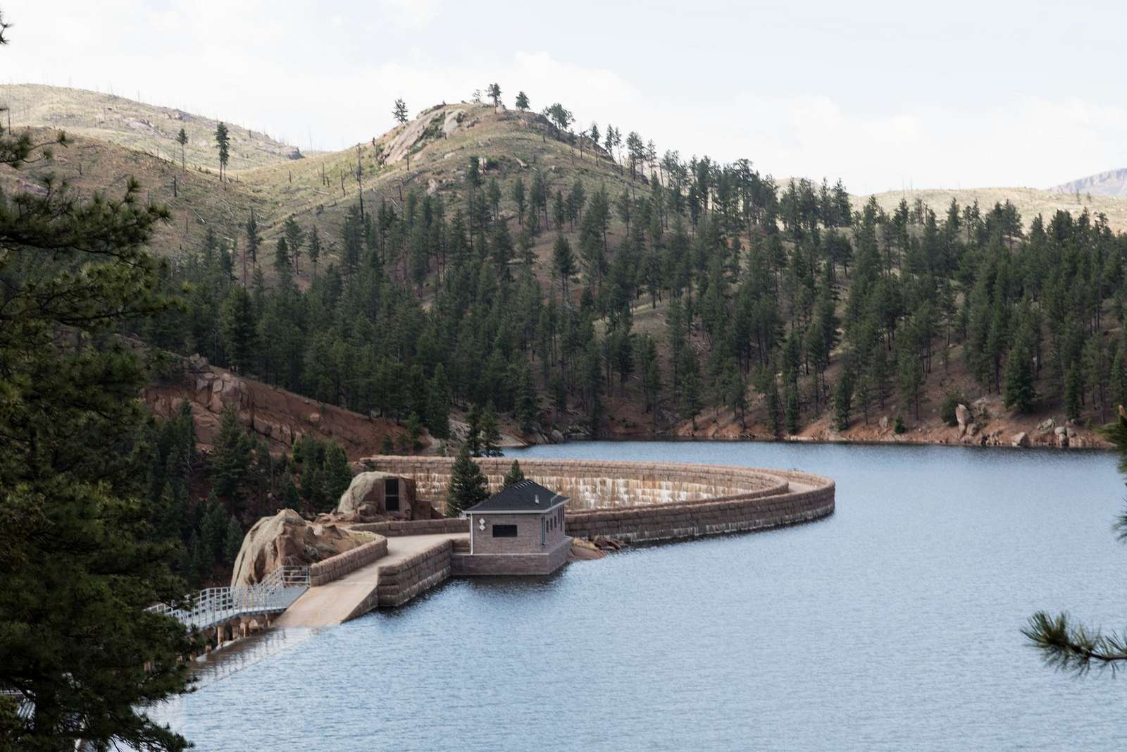View of the Cheesman Dam from its vast reservoir in Jefferson County, Colorado. Cheesman is one of the dams that slows and captures water from the South Platte River for use as part of Denver's drinking-water supply. Cheesman Dam, which was named for Walter Scott Cheesman, a Denver druggist, railroad builder, and designer of water infrastructure, was the world's tallest at 221 feet when it was completed in 1905
