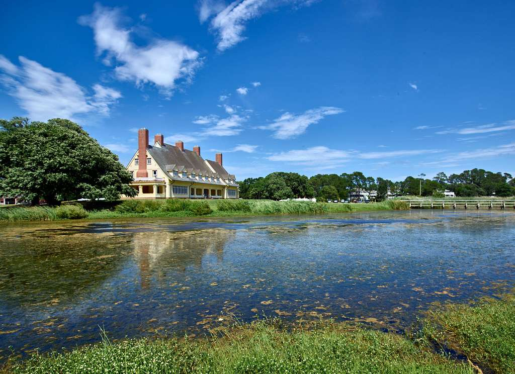 """Whalehead, a luxurious home later converted into a fancy clubhouse, was built by northern industrialist Edward Collings Knight, Jr. and his wife, Marie Louise LeBel, in 1922, on the sleepy town of Corolla on the shores of Currituck Sound on North Carolina's Outer Banks, a 200-mile-long string of barrier islands and Splits off the coast that locals like to call the """"OBX"""""""