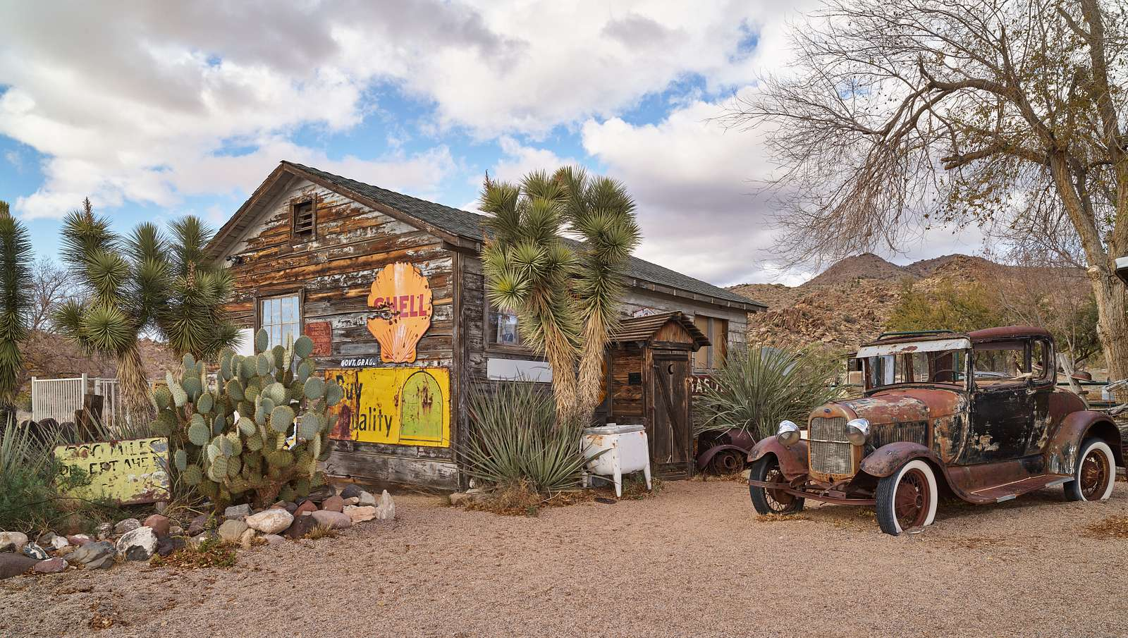 """An old, rusted car, or """"jalopy,"""" is actually a nostalgic roadside attraction at the venerable Hackberry General Store in the tiny settlement of Hackberry, Arizona """"a vestige of the heyday of two-lane cross-country travel in the 1930s and 40s along U.S. Highway 66"""