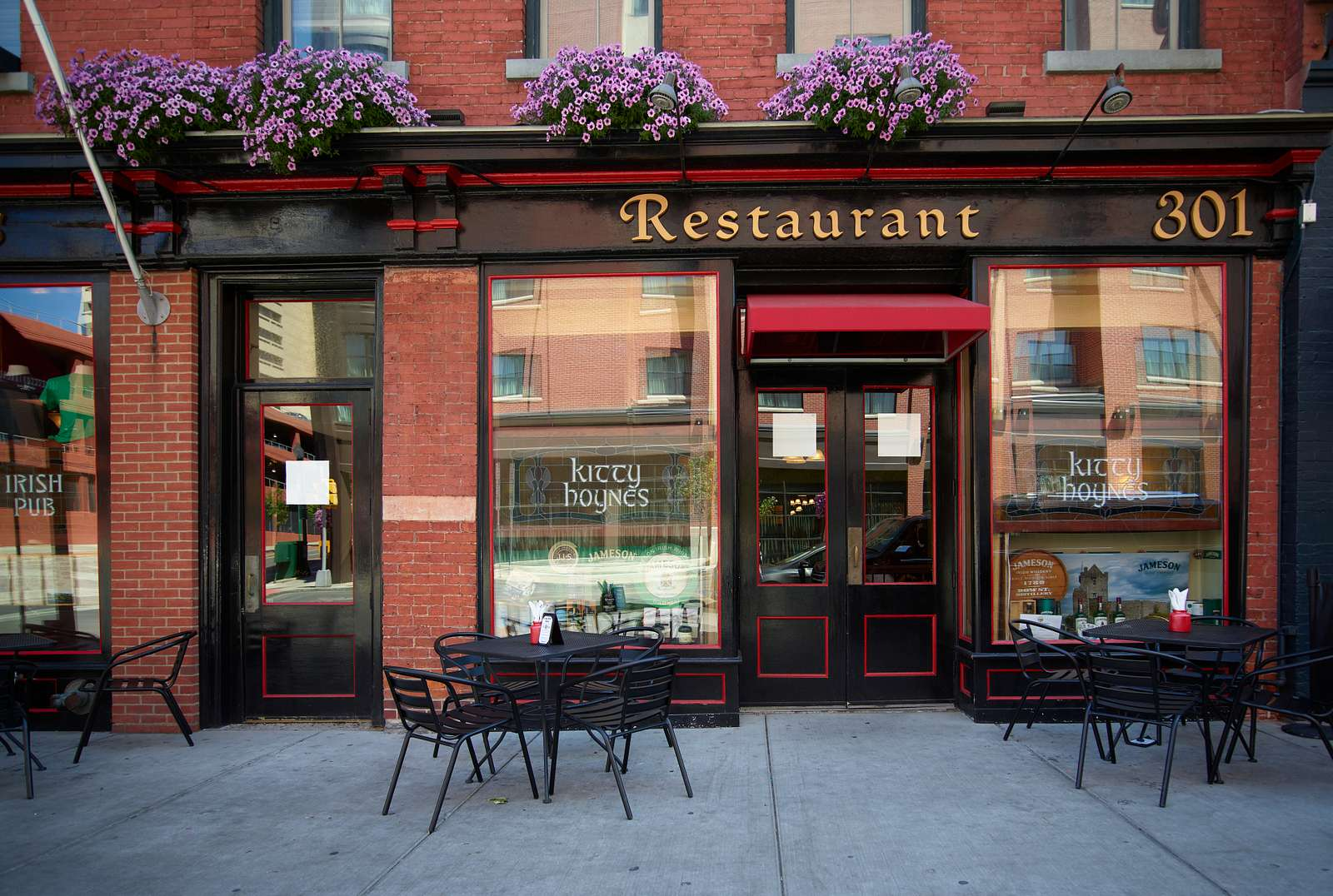 Festooned flower boxes above the entrance lend a European flavor to a downtown restaurant in Syracuse, New York