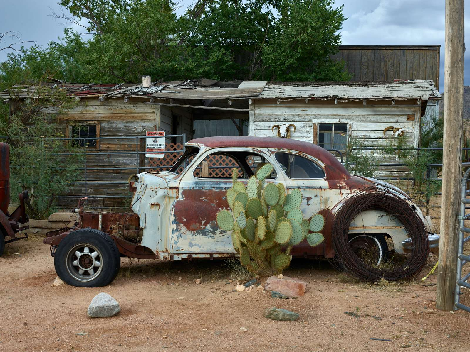 Most, but not all, of an old, rusted car along historic U.S. Route 66 in Hackberry, Arizona