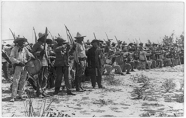 Mayo Indians with bows & arrows joining Obregon in Rio Mayo