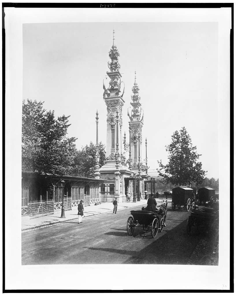 [Entrance to exhibits on the Quay d'Orsay, showing carriages along street, Paris Exposition, 1889]