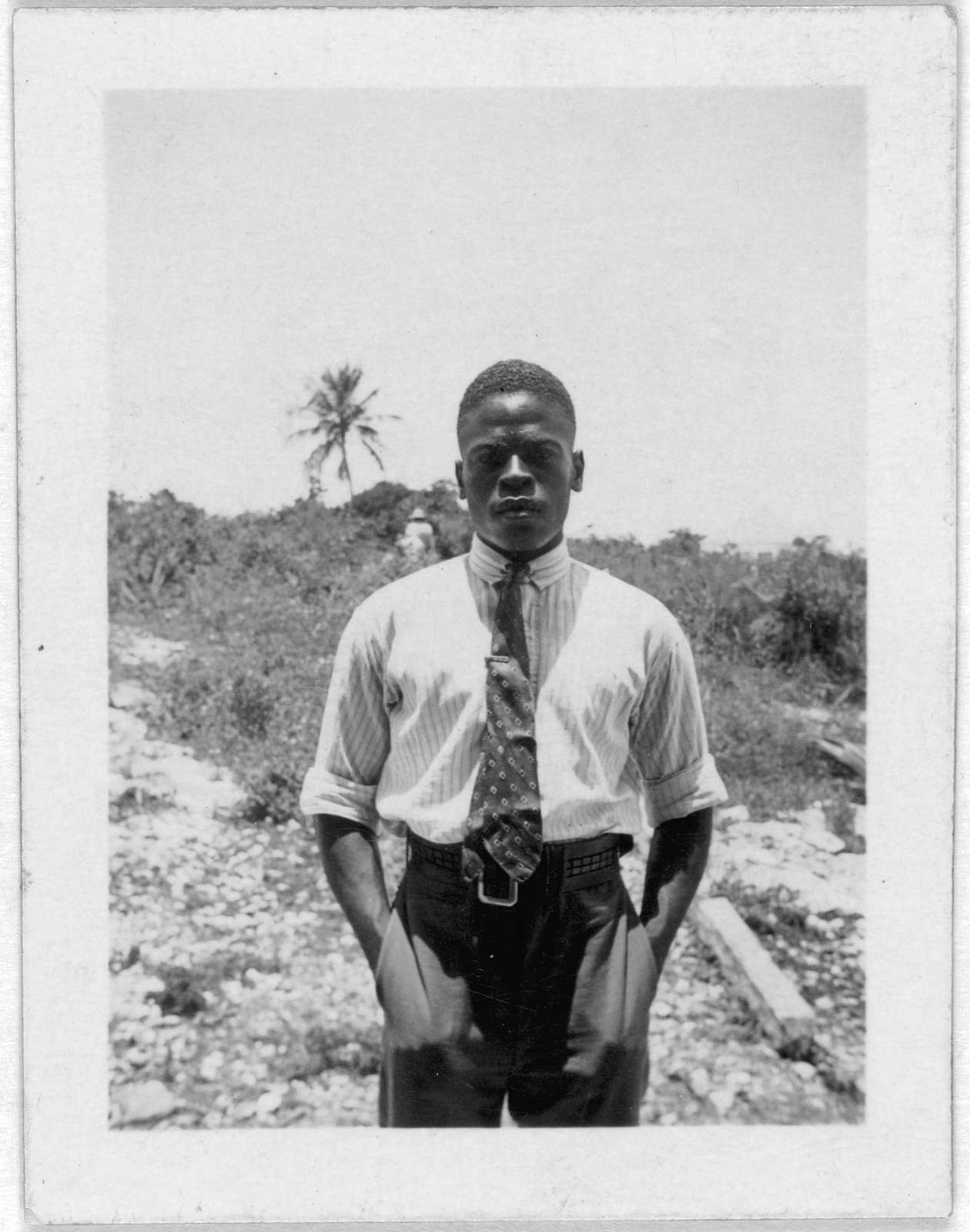 [Man wearing tie, standing, facing front, possibly from the visit by Alan Lomax and Mary Elizabeth Barnicle to Andros Island in the Bahamas]