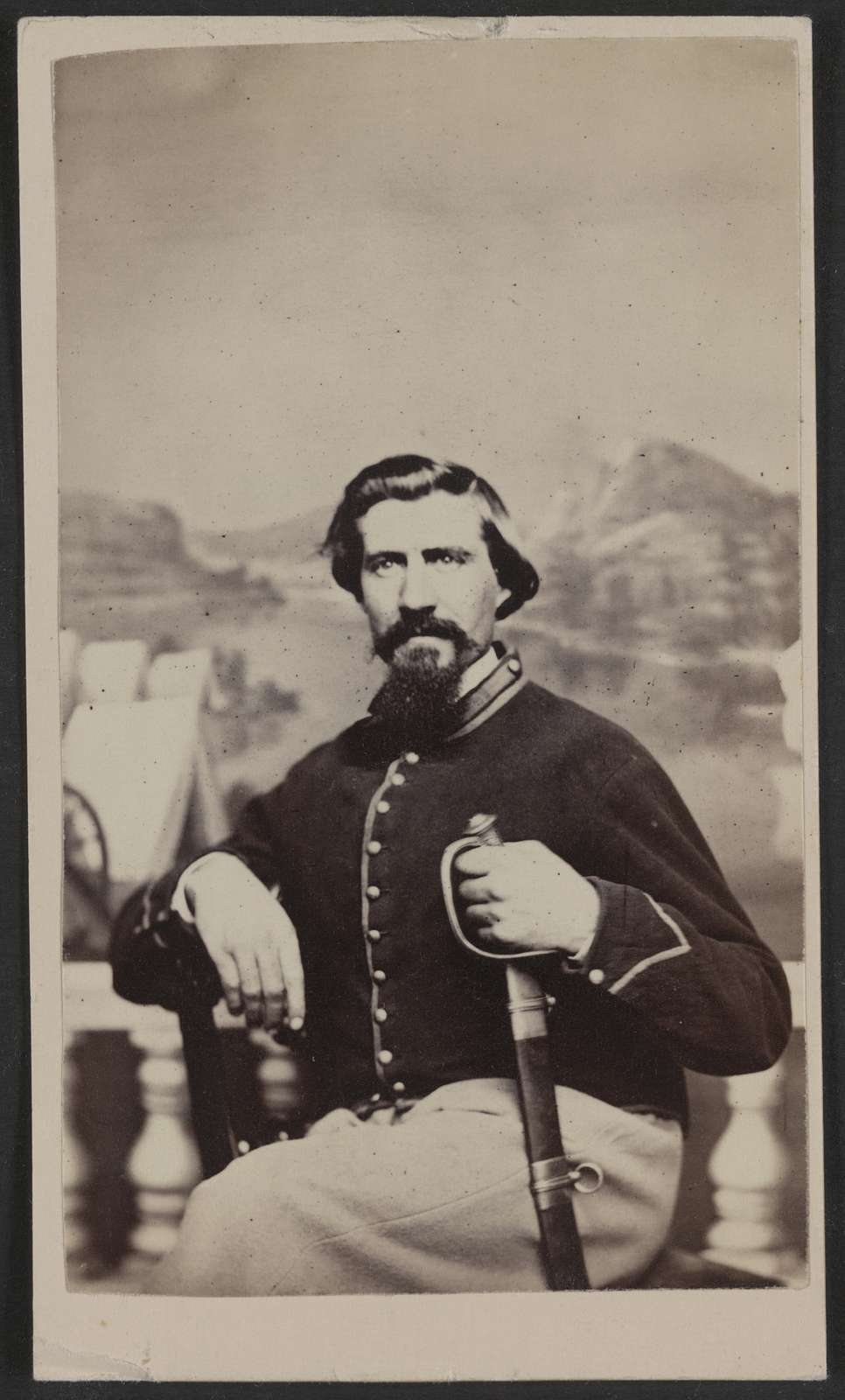 [Soldier named Halsey in Union uniform with sword in front of painted backdrop] / Jno. Holyland, Metropolitan Gallery, 250 Pennsylvania Ave., Washington, D.C.