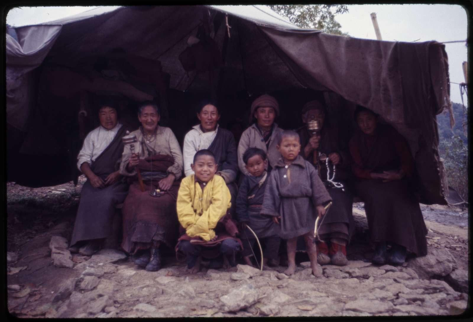 Traveling Tibetan tribe, grandmothers spinning prayer wheels