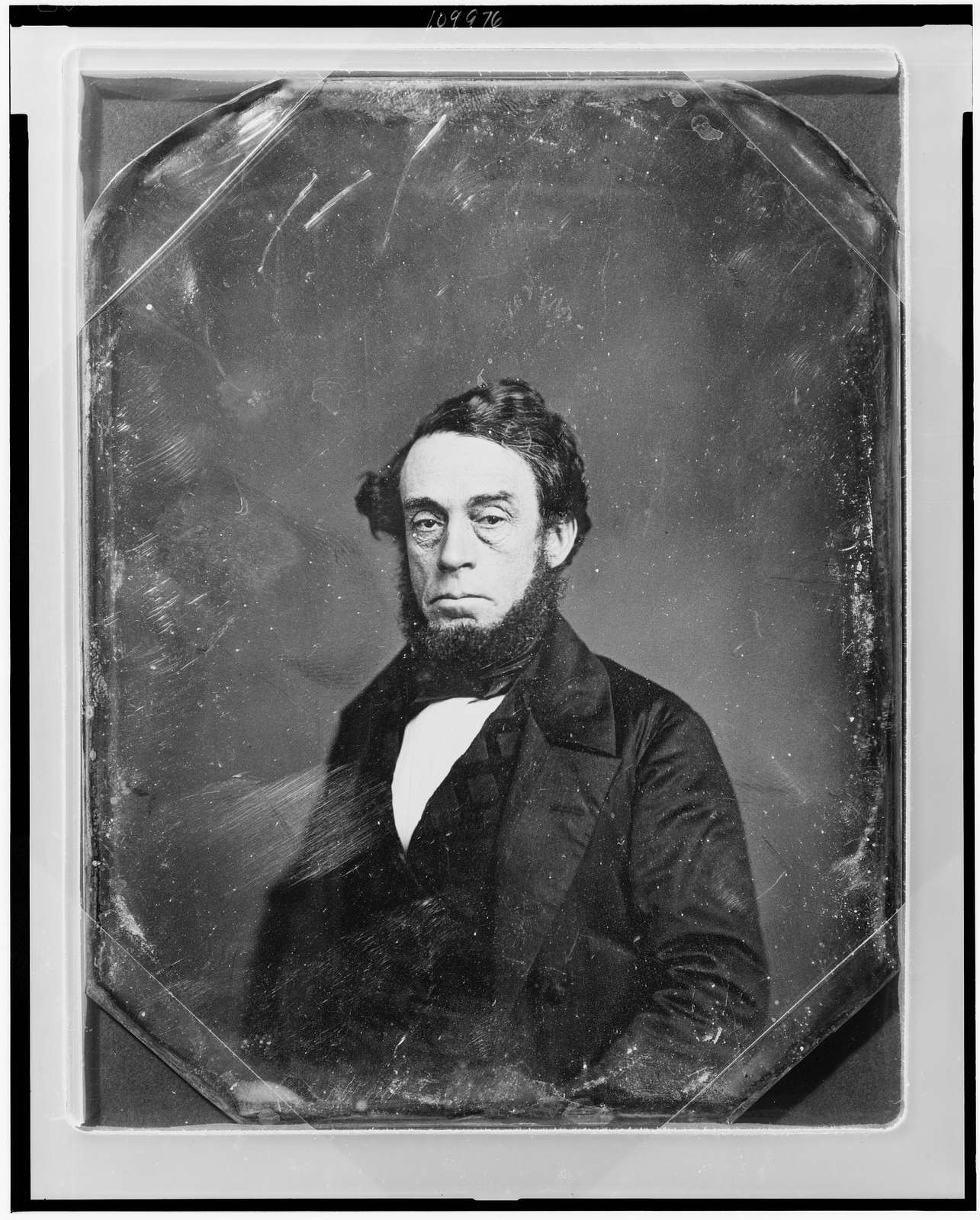 [Unidentified man, half-length portrait, three-quarters to the left, eyes facing front, with beard]