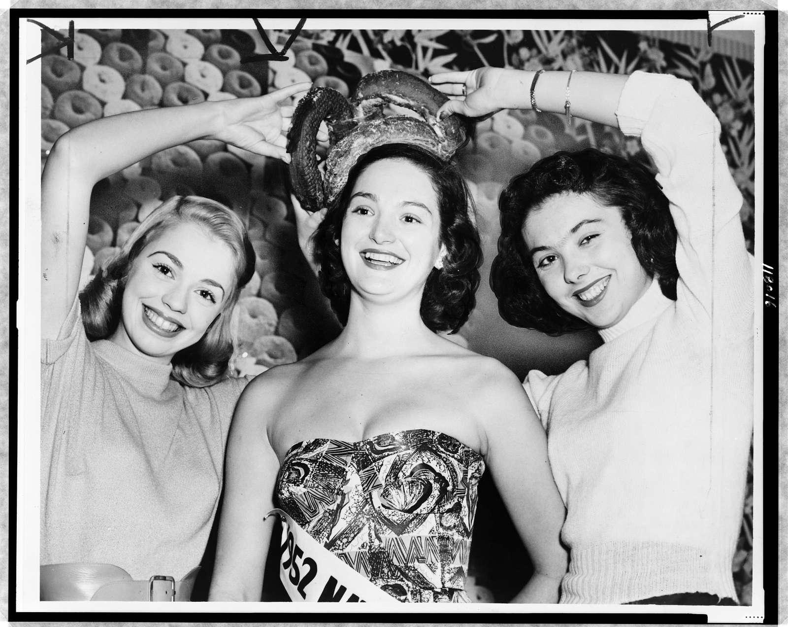 [Diane Scholen, left, and Pat Kizeminski, right (runners-up) place doughnut crown on Nancy Templeton, National Doughnut Queen] / World Telegram & Sun photo by Fred Palumbo.