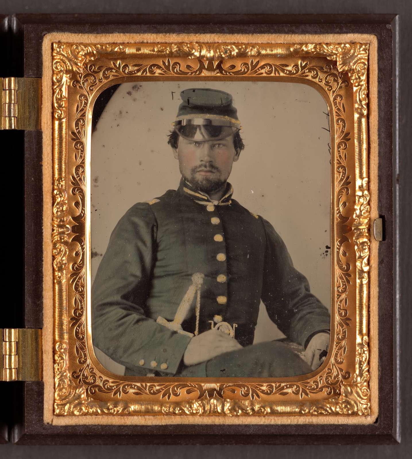[Lieutenant Thomas S. McLane of Co. A, 41st Georgia Infantry Regiment, in uniform with sword]