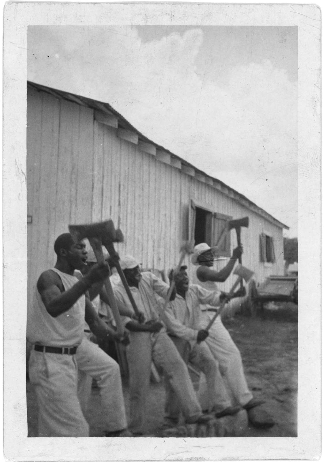 """[""""Lightnin'"""" Washington, an African American prisoner, singing with his group in the woodyard at Darrington State Farm, Texas]"""