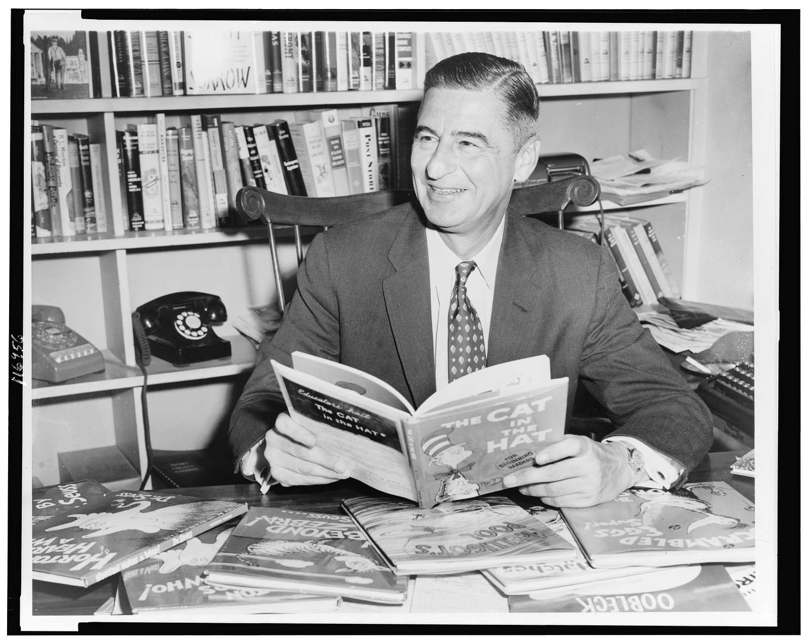 Ted Geisel (Dr. Seuss) half-length portrait, seated at desk covered with his books] / World Telegram & Sun photo by Al Ravenna. - Library Of Congress Public Domain Image