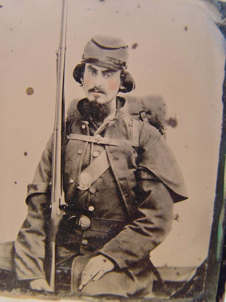 [Unidentified soldier in Union uniform with musket, knapsack, and bedroll]