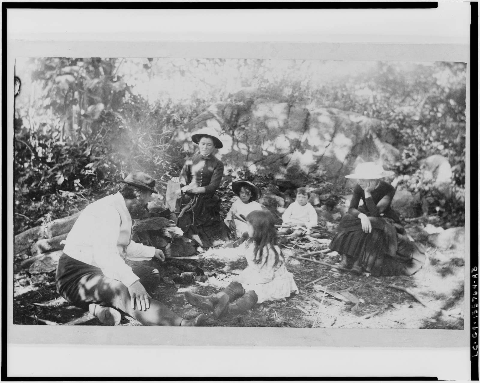 [Alexander Graham Bell and family with a nurse (center) on a picnic at House Island]