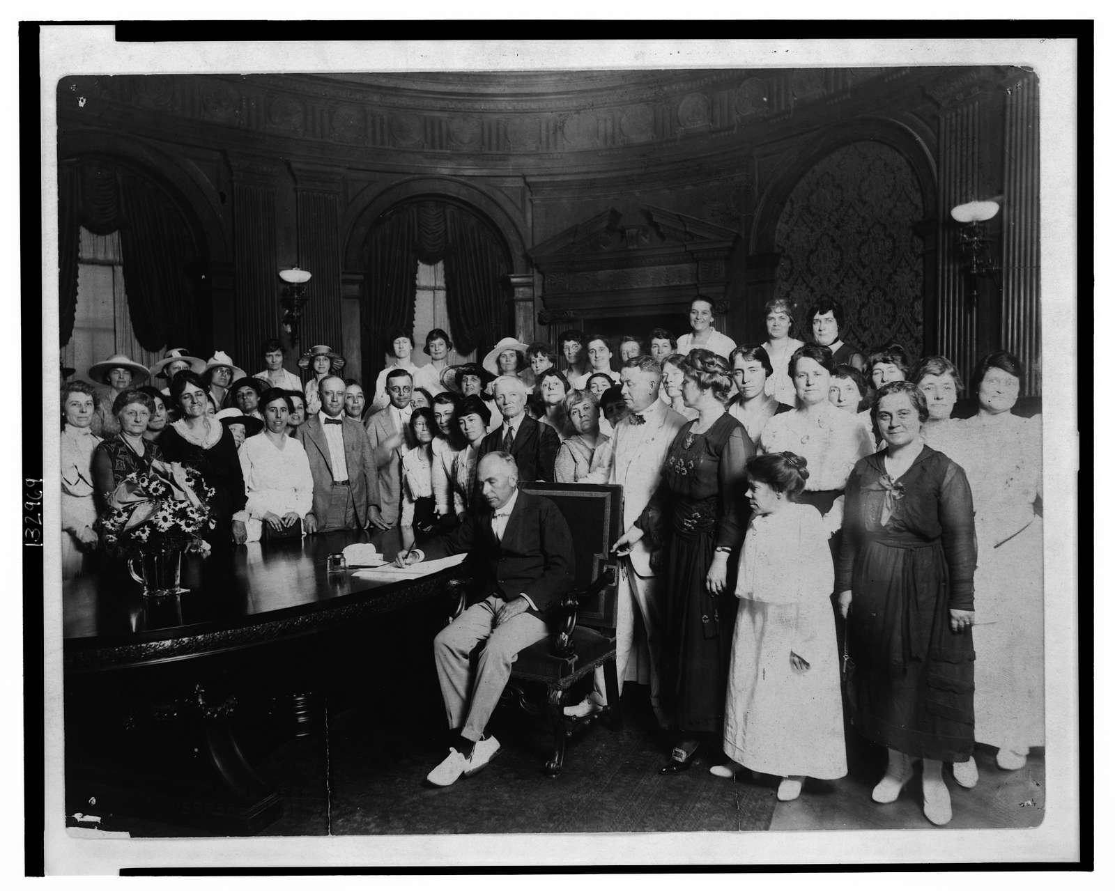 Gov. Gardner signing resolution ratifying amendment to U.S. Constitution granting universal franchise to women / Carl Deeg.