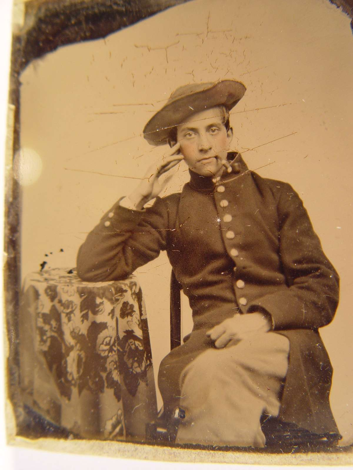 [Unidentified young soldier in Union frock coat and slouch hat smoking pipe]